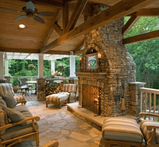 Covered Deck With Custom Stone Fireplace Amazing