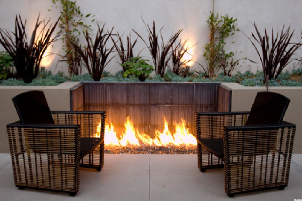fire pit built into wall- patio fireplace designs- amazing deck