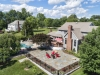 Cobblestone Patio Design with Firepit and Pool Designs- Amazing Deck