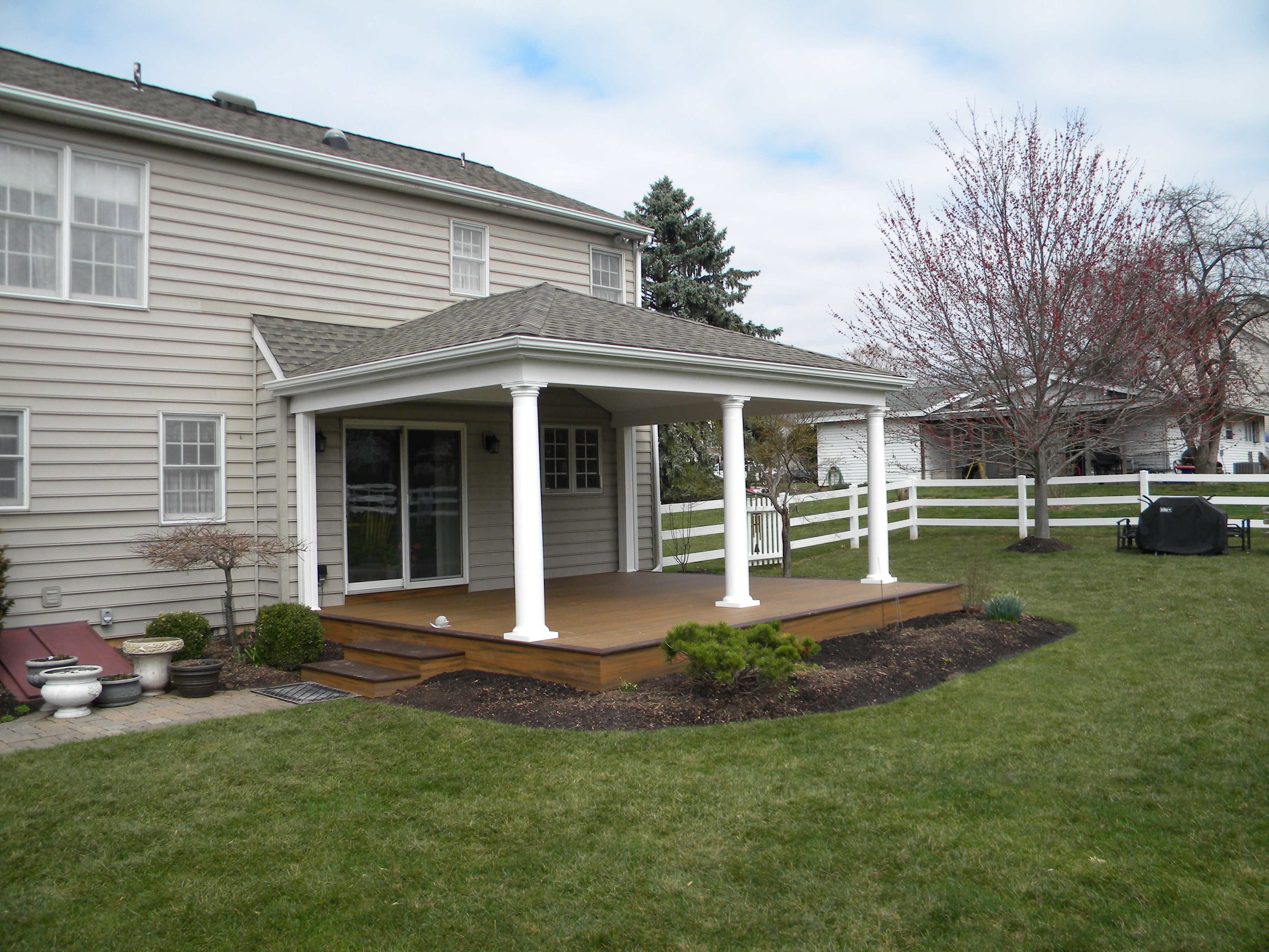 - Trex Transcend Spiced Rum and Vintage Lantern Deck, Vintage Lantern Rail with White Posts and Black Balusters.  Custom Pergola, Stone Skirting, Paver Patio, Fire Water Features and an Outdoor Kitchen- Newtown, PA