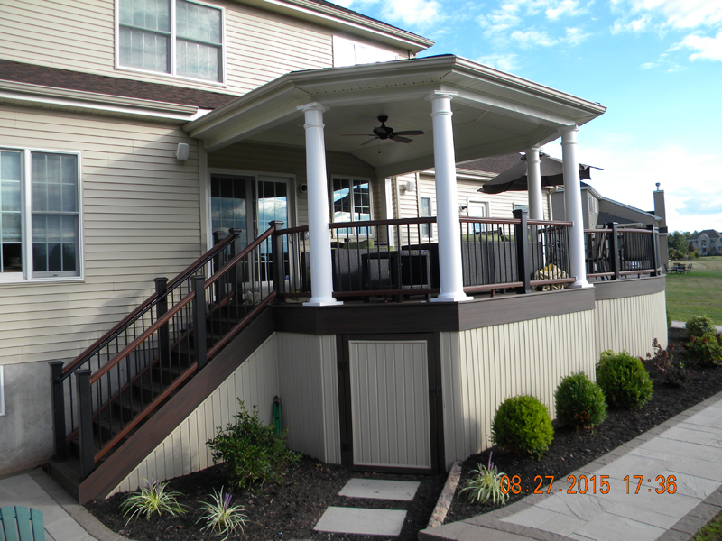 Decks with roofs covered deck builder amazing decks for Covered decks