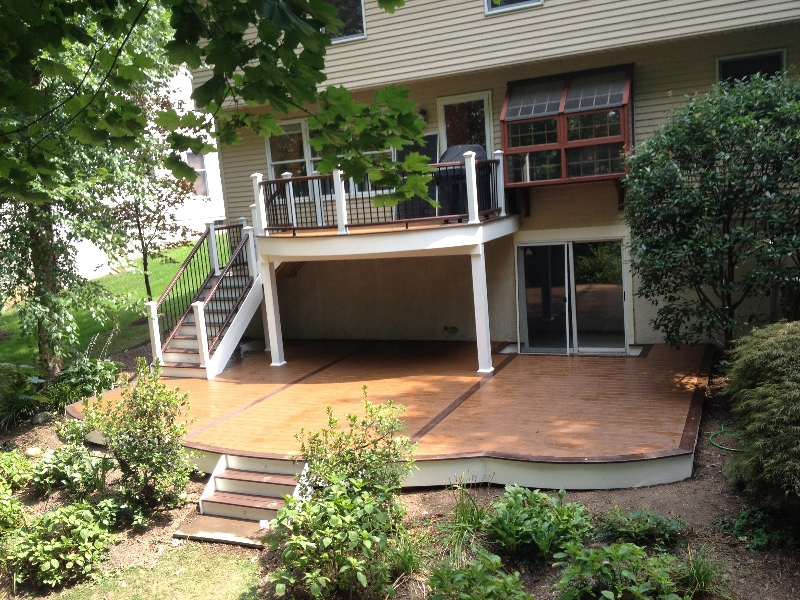 Curved deck designs deck contractor amazing decks for Walkout basement patio ideas