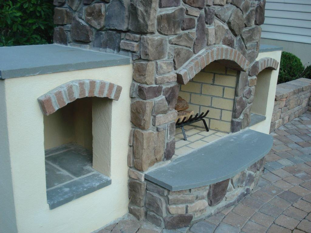 Custom Outdoor Fireplace- Amazing Decks